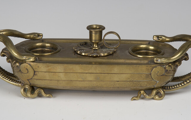 A mid-19th century gilt bronze inkstand, finely cast in the form of a boat with serpent handles, the