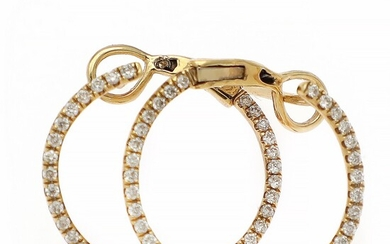 A pair of diamond ear pendants each set with numerous brilliant-cut diamonds, mounted in 18k gold. Diam. app. 17 mm. (2)