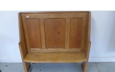 A pine hall bench with with a panelled back 117cm tall x 115...