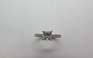 A platinum princess cut diamond ring with diamond set should...
