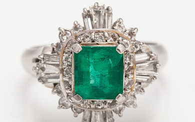 A platinum ring with a ca. 1.15 ct emerald and ca. 1.00 cts of diamonds in total.