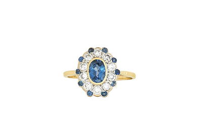A sapphire and diamond cluster ring, retailed by Joseph Bonnar