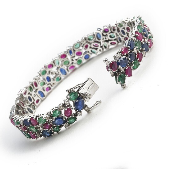 "A sapphire, ruby, emerald and diamond bracelet ""Tutti Frutti"" set with numerous sapphires, rubies, emeralds and diamonds, mounted in 14k white gold."
