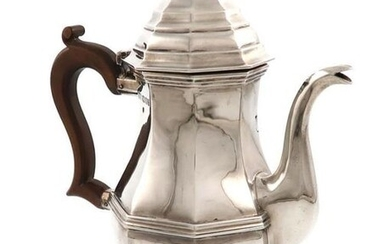 A silver coffee pot, by Carrington and Co.,...