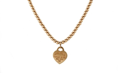 AN 18CT YELLOW GOLD BEADED NECKLACE, with heart pendant, by ...