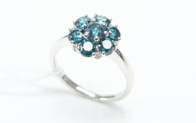 AN ENHANCED BLUE DIAMOND AND DIAMOND DRESS RING IN 18CT WHITE GOLD, OF FLORAL DESIGN FEATURING SEVEN BLUE DIAMONDS TOTALLING 1.54CTS...