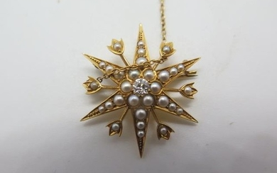 An 18ct gold diamond and seed pearl star shape brooch, the c...