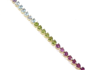 An 18ct gold heart-cut multi-gem line bracelet, including am...