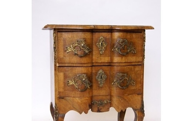 An early 20th century French walnut two drawer commode with ...
