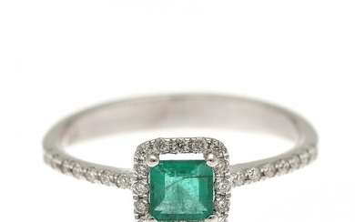 An emerald and diamond ring set with a carré-cut emerald encircled by numerous brilliant-cut diamonds, mounted in 14k white gold. Size 54.5.
