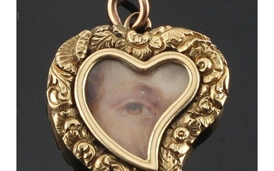 An unmarked yellow gold heart shaped pendant set with a mini...