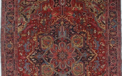 NOT SOLD. An antique Heriz carpet, North West Persia. Classical medallion design. Early 20th century....
