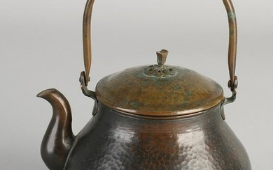 Chinese antique copper teapot beaten with rosette.