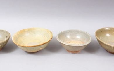 FOUR EARLY CHINESE POTTERY GLAZED BOWLS, some glazed,