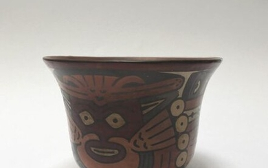 Flared polychrome terracotta bowl decorated with a fantastic creature with a snake head, holding a knife, 3 heads cut along its body and one at the end of its tail. Nice state of preservation.