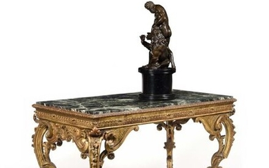 Gilded wood middle table, with openwork decoration (all sides) of foliage and garlands, canals, trellises and palmettes, resting on console legs ending in hooves. Early 18th century, circa 1720, H: 76 cm, W: 108 cm, D: 59 cm Provenance: Former...