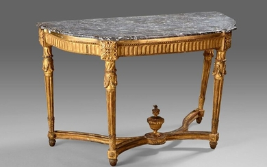 Half moon console in gilded stuccoed wood decorated with acanthus, garlands and water leaves. Tapered fluted legs joined by a sinuous spacer centered on a fire pot.