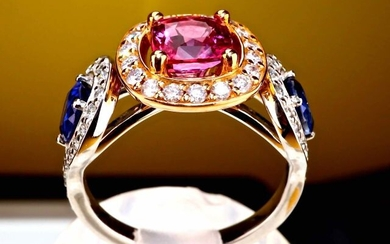 High Jewelry. Exceptional Ring set with a Rare Padparadja Pink Sapphire of Ceylon AA transparent for 1.39 carat certified IGE natural unheated untreated and 2 pear cut blue sapphires transparent for 1.11 carat surrounded by high quality natural...