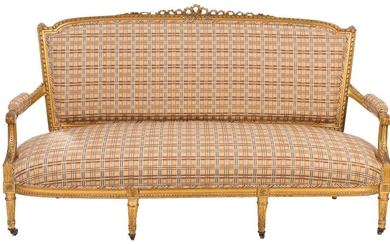 Louis XVI style sofa in carved and gilded wood with checkered upholstery. France, 19th century. Front legs with wheels. 104 x 92 x 186,5 cm