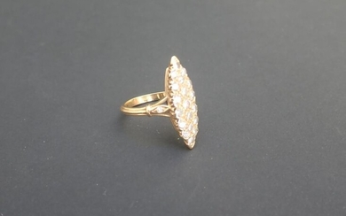 Marquise ring in 750°/°° (18K) yellow gold paved with round diamonds cut in modern brilliance (approx. 0.40 carats in total). Finger size: 52.Gross weight: 6.50 g.