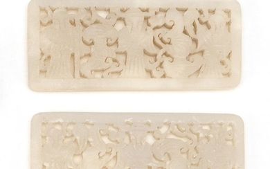 "PAIR OF CHINESE WHITE JADE OPENWORK-CARVED RECTANGULAR PLAQUES With figural decoration. Length 3""."