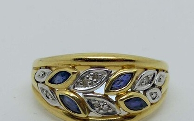 RING openworked in two golds, set with small shuttle sapphires and diamond chips. Gross weight 3.4 g.
