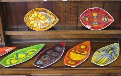 Six Poole Pottery Delphis boat shaped dishes, 44cm long, fou...