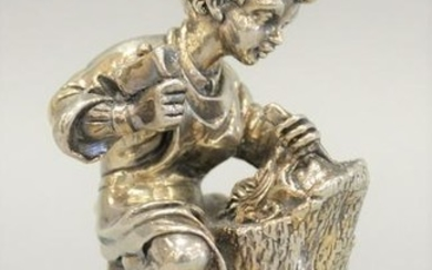 """Sterling silver figure seated boy with tools, 5 1/4""""."""