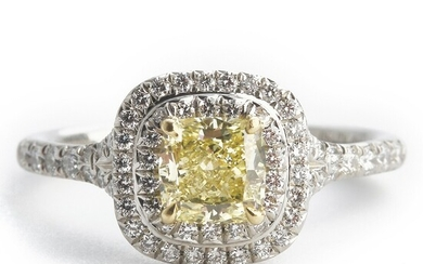 """Tiffany & Co.: A diamond ring """"Soleste"""" set with a cushion-cut natural fancy yellow diamond weighing app. 0.80 ct., mounted in platinum and 18k gold. Size 52."""