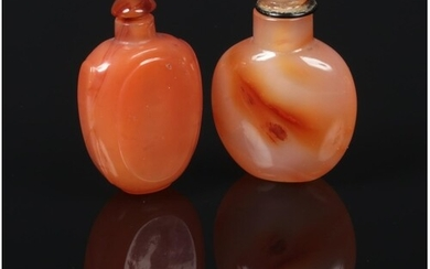 Two 18th century Chinese carved orange agate snuff bottles a...