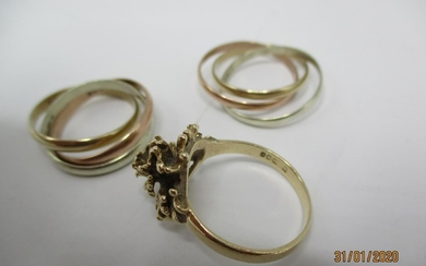 Two 9ct gold Russian tri-coloured rings and a 9ct gold flowe...