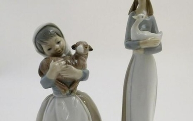 Two Nao figures of girls holding animals, Girl Holding