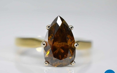 Yellow gold ring with fancy cognac colored diamond.