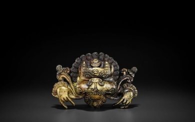 A COPPER REPOUSSÉ AND RELIEF FIGURE OF A...