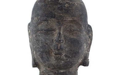 A Carved Stone Head of Buddha.