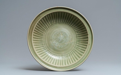 A Chinese Longquan celadon dish with incised floral...