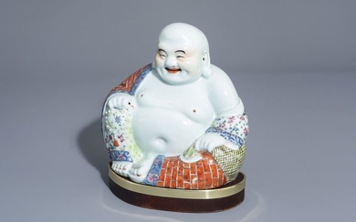 A Chinese famille rose figure of Buddha, 19th/20th...