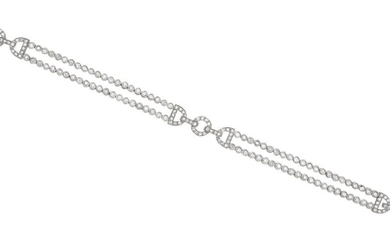 A DIAMOND BRACELET - Of Art Deco style, comprising a double row of collet set diamonds with a central geometric panel and conforming...