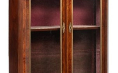 A French Empire style mahogany display cabinet with...
