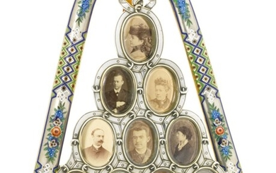 A LARGE CHAMPLEVÉ AND EN PLEIN ENAMEL PARCEL-GILT SILVER PHOTOGRAPH FRAME SHAPED AS A HORSE YOKE, MARKED SAZIKOV WITH IMPERIAL WARRANT, ST PETERSBURG, 1880