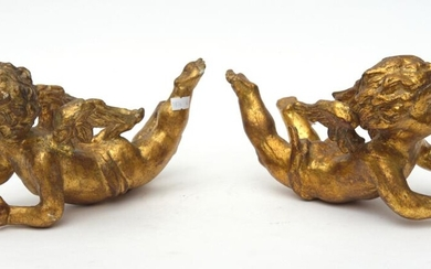 A PAIR OF 19TH CENTURY CARVED WOODEN GILDED FLORENTINE CHERUBS