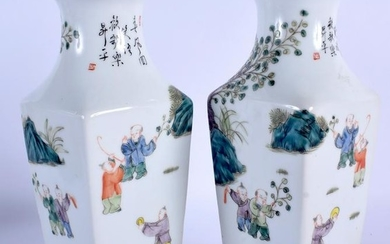 A PAIR OF CHINESE FAMILLE ROSE PORCELAIN VASES. 22.5 cm