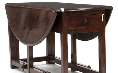A Philippine hardwood drop-leaf table. Late 19th century. H. 72 cm. L. 62/138 cm. D. 130 cm.
