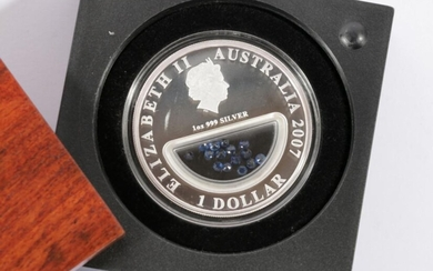"""A Queen Elizabeth II (2007) 1 oz pure silver Dollar """"Treasures of Australia"""" with Sapphire Inserts by The Perth Mint, coin no.4289/7500"""