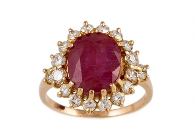 A RUBY AND DIAMOND OVAL CLUSTER RING, the oval cut ruby to a...