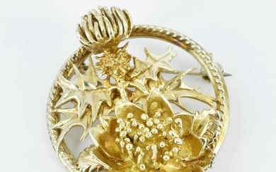 A STERLING SILVER AND GILT BROOCH