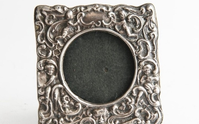 A STERLING SILVER BIRMINGHAM HALLMARKED EMBOSSED PHOTO FRAME, 10.5 CM HIGH, LEONARD JOEL LOCAL DELIVERY SIZE: SMALL