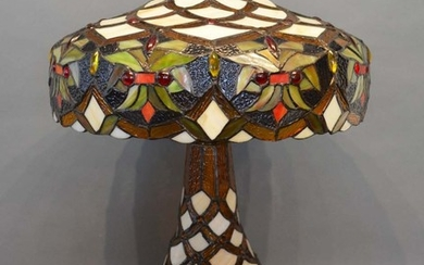 A Tiffany Style Glass and Metal Mounted Table Lamp with shad...
