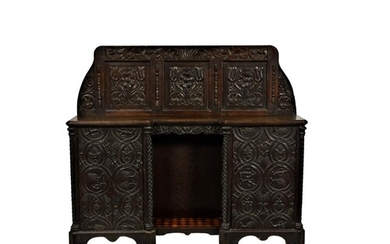 A Victorian carved oak side cabinet, made using some earlier...
