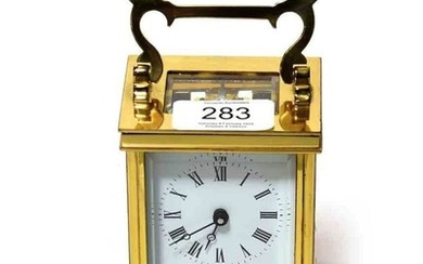 A brass carriage timepiece, dial signed Charles Young England, 20th...